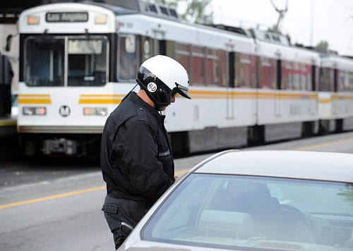 LAPD cites safety violator at Metro Blue Line crossing. Photo by Juan Ocampo.
