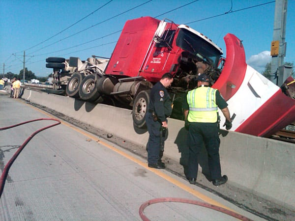 Big rig overturns onto the Metro Gold Line tracks from the 210 freeway. Photo: Metro/Luis Inzunza