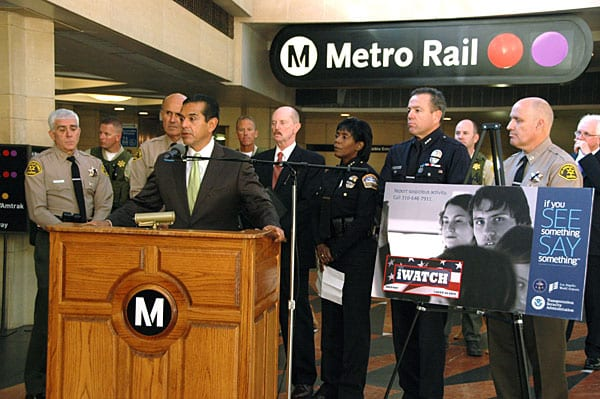 Los Angeles Mayor Antonio Villaraigosa leads news conference to launch national safety awareness campaign. Also participating (background, from left) are Sheriff Lee Baca, TSA Federal Security Director Randy Parsons, LAWA Airport Police Asst. Chief Ethel McGuire, LAPD Assistant Chief Michael Moore, and LASD Capt. Pat Jordan. Photo by Luis Inzunza.