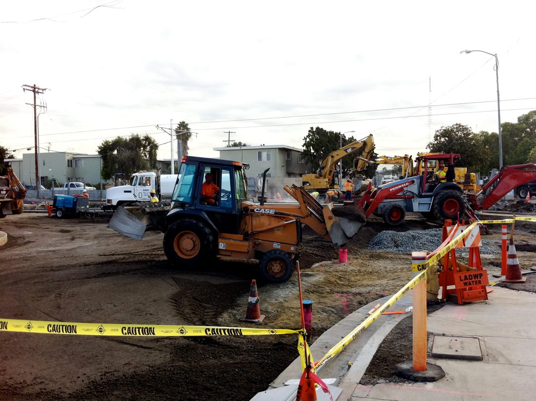Construction workers rebuild the intersection of Exposition Blvd. and Farmdale Ave. in for the street crossing and station stop.