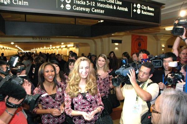 2012 Rose Queen Drew Helen Washington, at left, Princess Morgan Eliza Devaud and Princess Kimberly Victoria Ostiller greet transit patrons at Union Station. Photos by Luis Inzunza