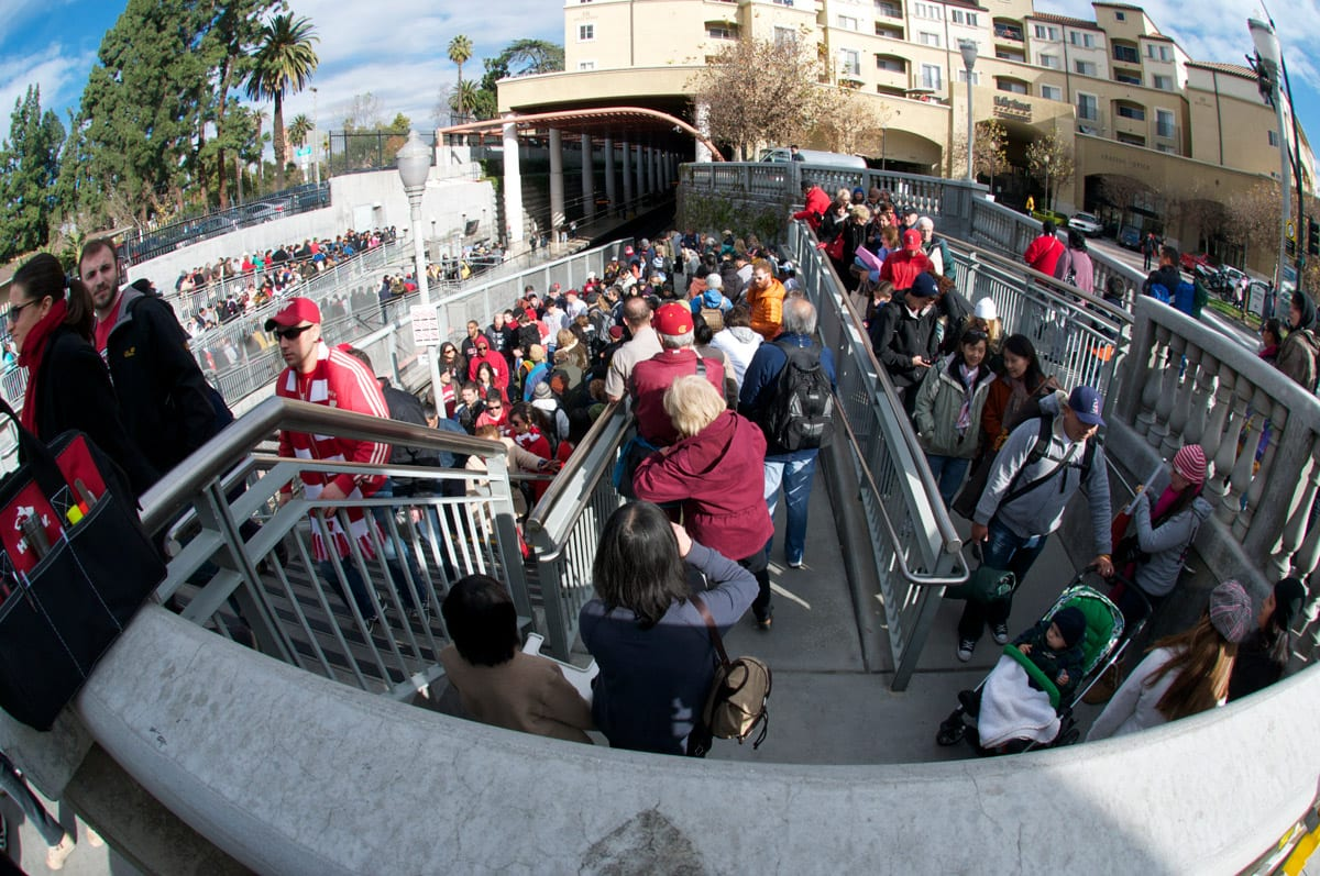 Parade goers exit as Rose Bowl fans arrive at Memorial Park Station. Photo by Gary Leonard.