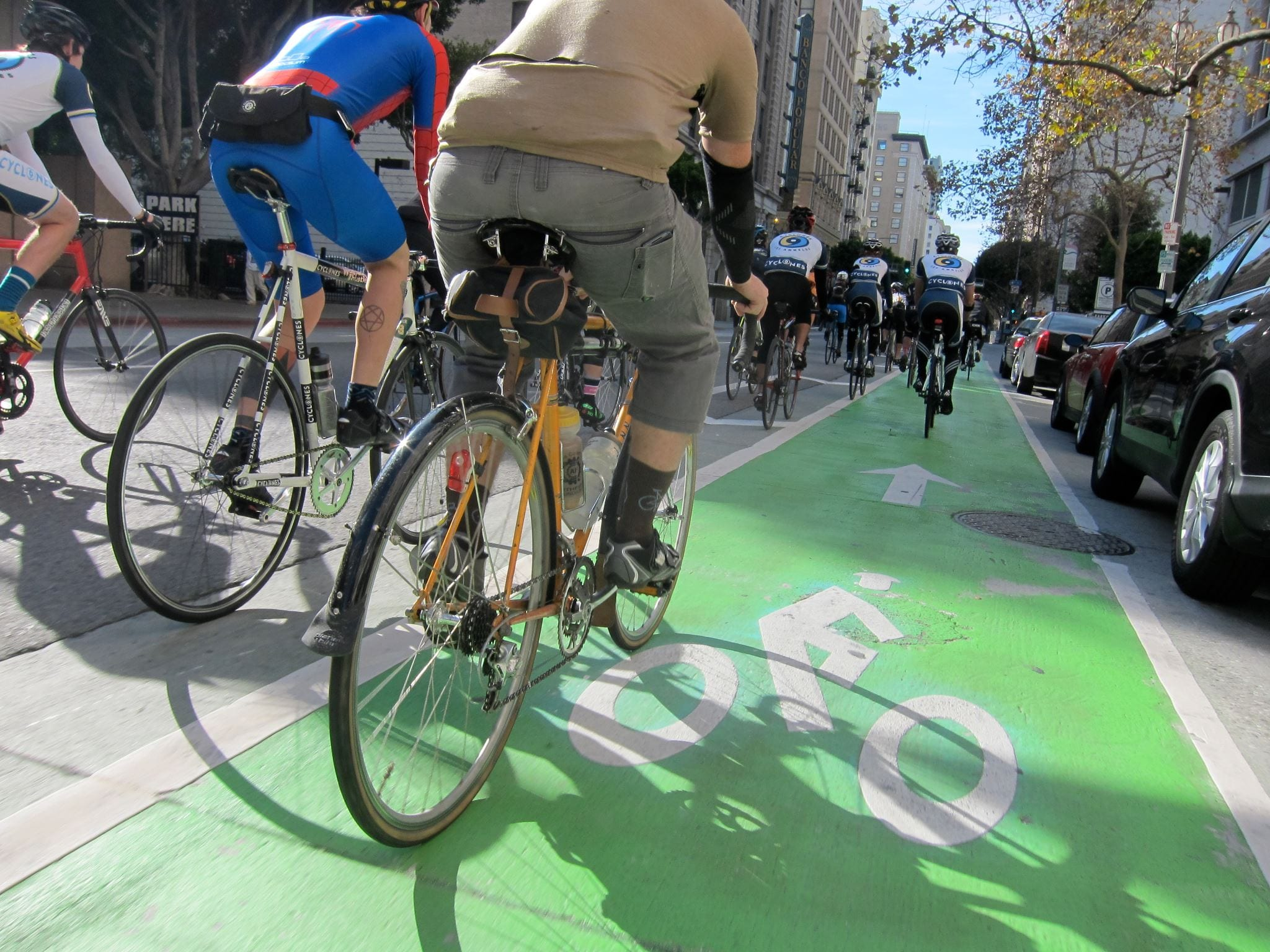Cyclists using Spring St.'s green bike lane. Photo by Jances Certeza.