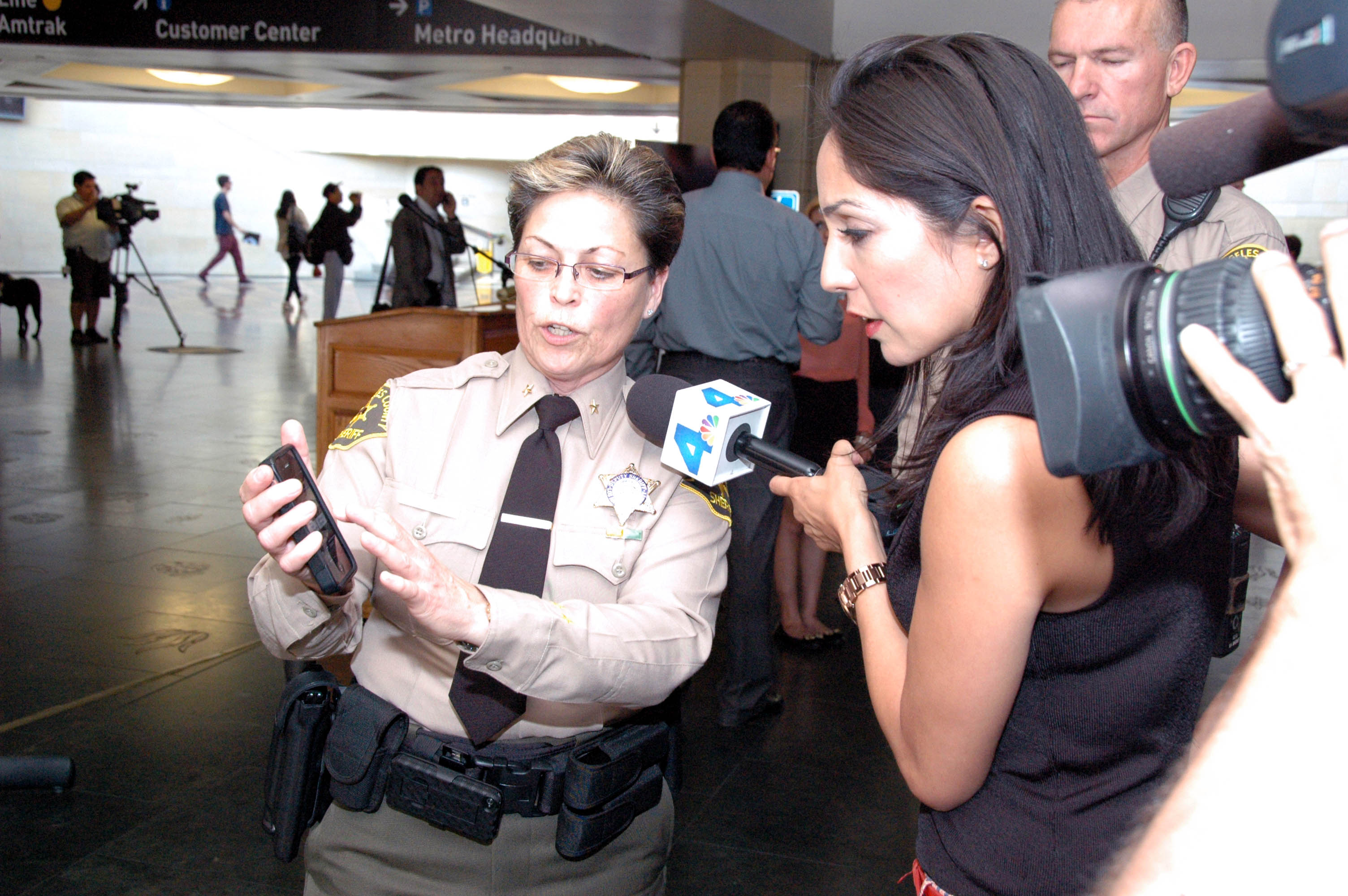 LASD Commander Ronene M. Anda shows the new app to the media at Union Station on Wednesday morning. Photo by Luis Inzunza/Metro.