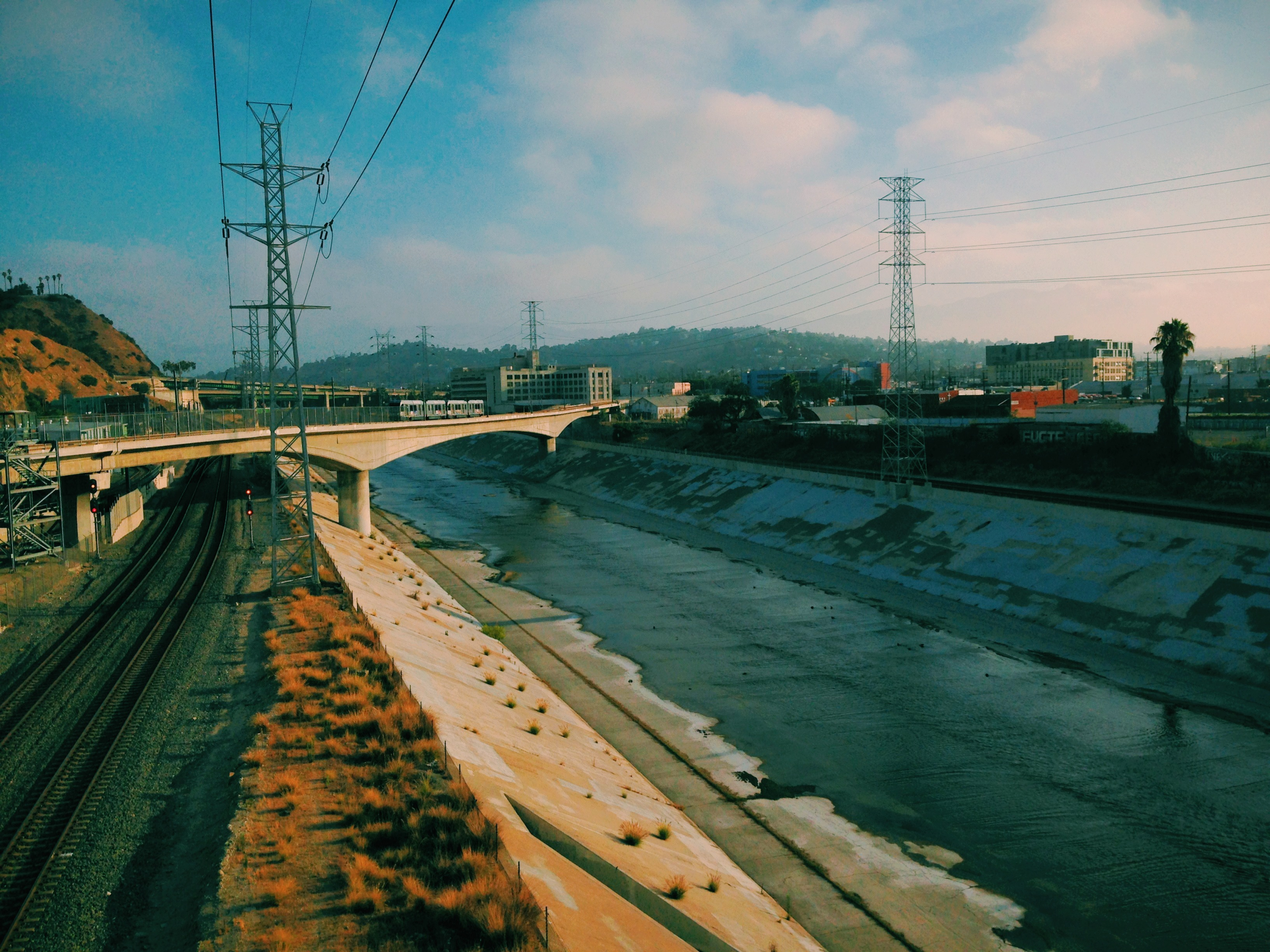 The L.A. River and the Gold Line as seen this morning from the Broadway Bridge. The photo was taken with the VSCOcam app for iPhone. Photo by Steve Hymon/Metro.