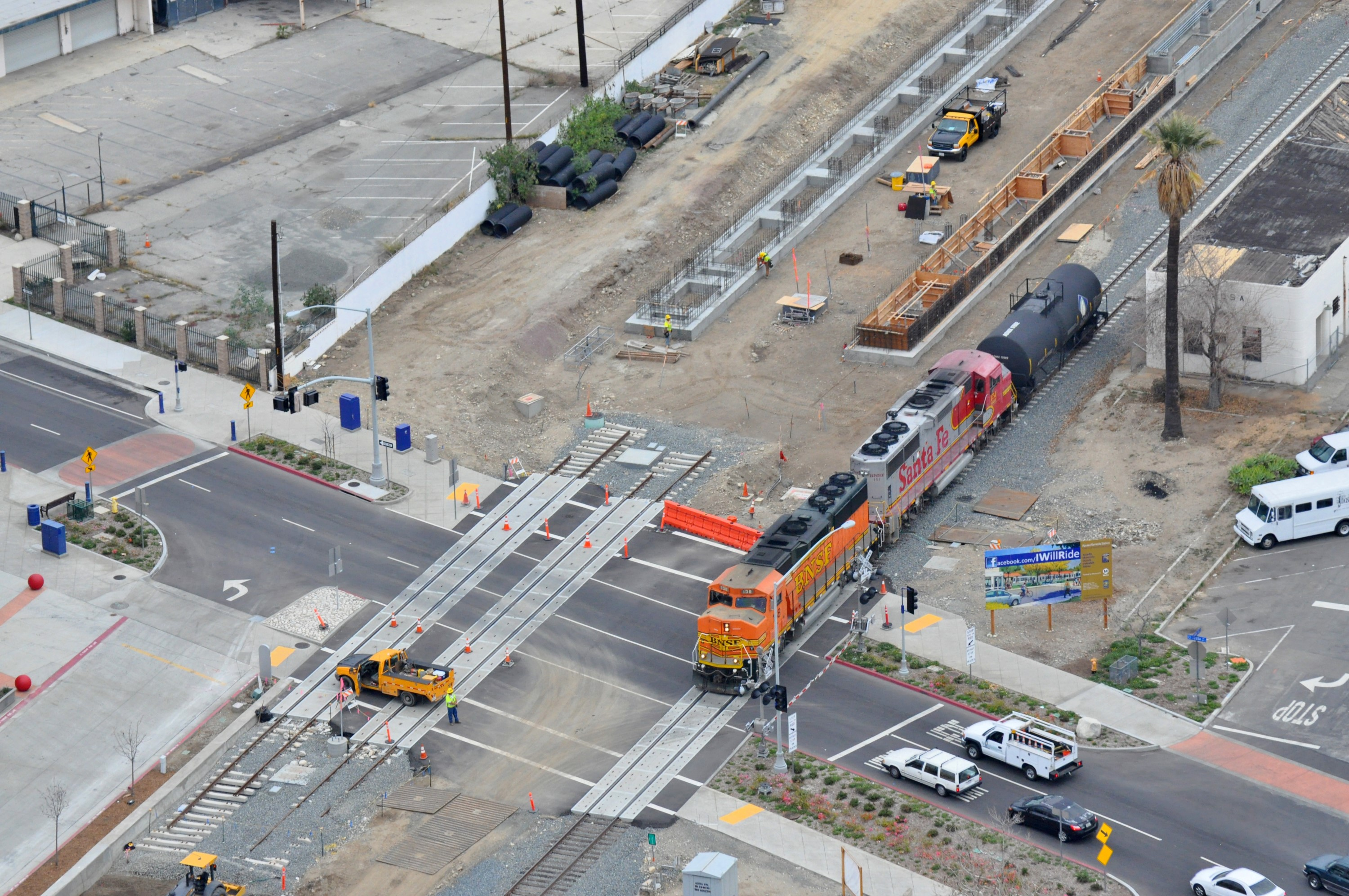 BNSF train crossing Azusa Avenue on relocated freight track in Azusa.