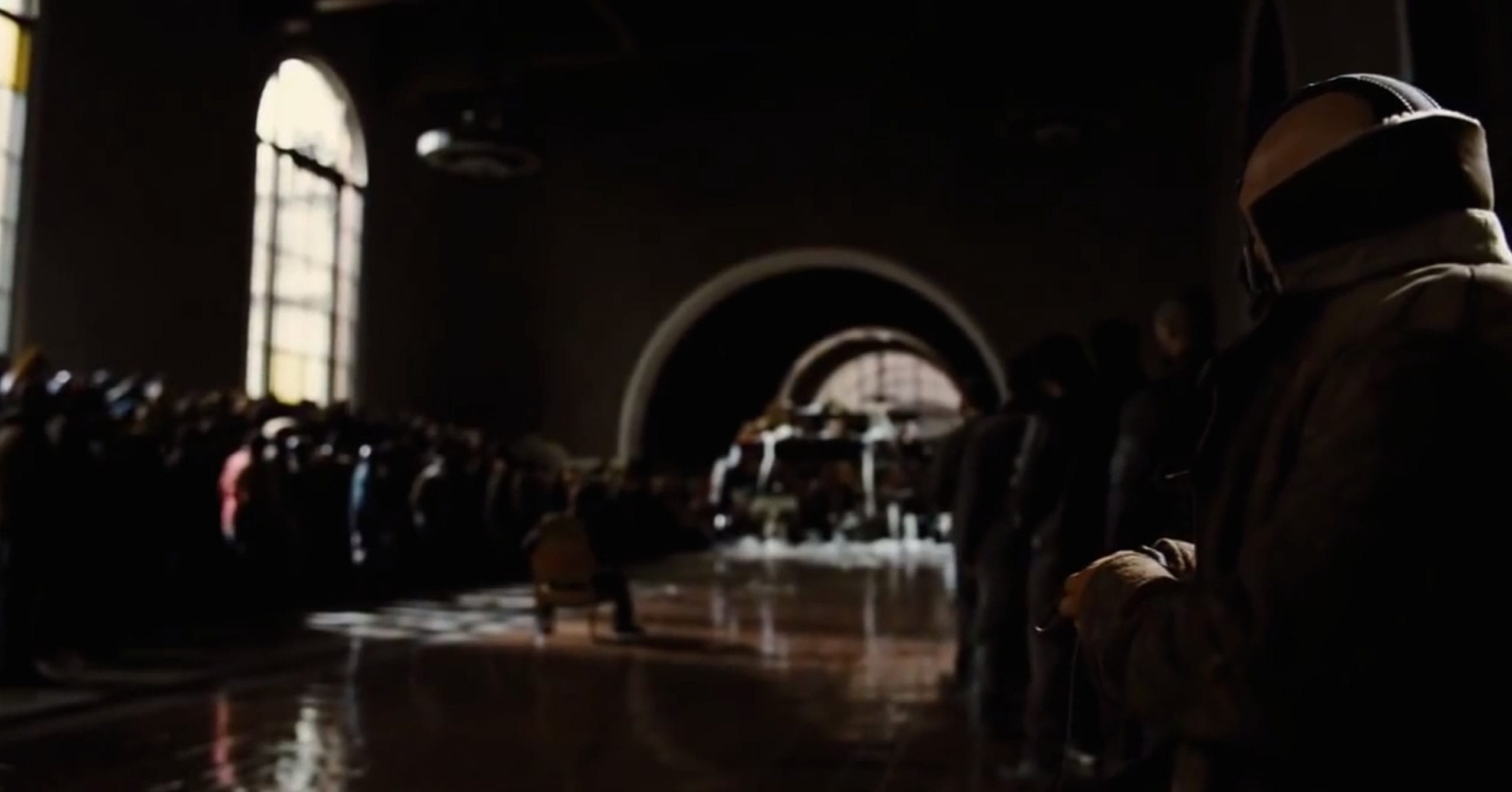 """A scene from the """"The Dark Knight Rises"""" that was filmed in the old ticket room  at Union Station. Credit: Warner Bros."""