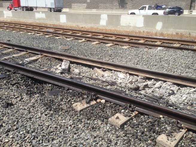 Fallen wire and damaged track near the resting place of the tractor-trailer.