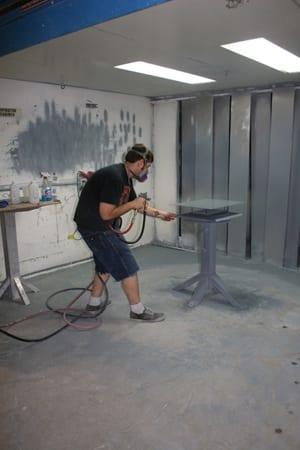 Winsor Fireform technicians preparing the steel and spraying porcelain enamel. Photo courtesy Winsor Fireform.