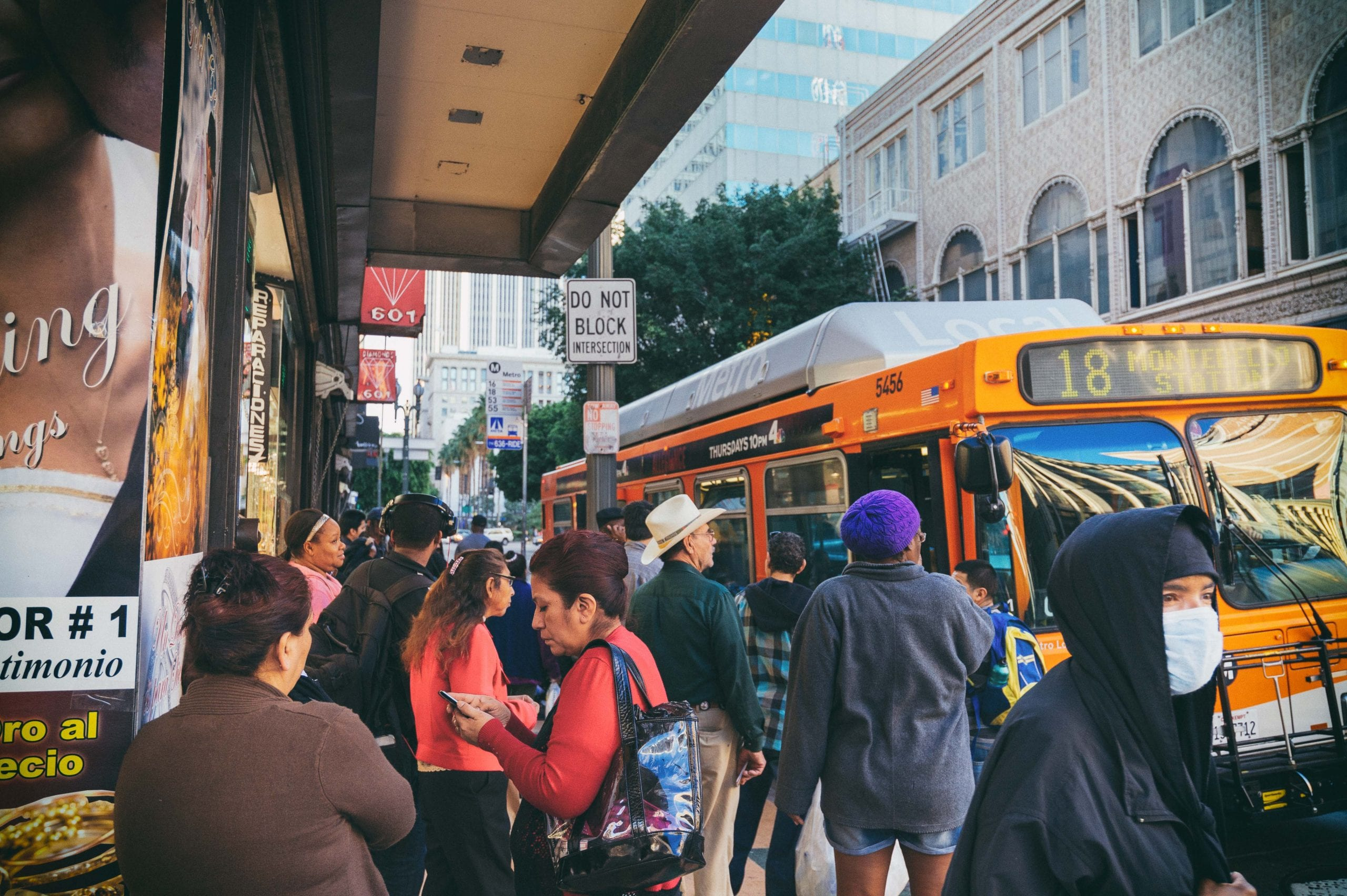 ART OF TRANSIT: The Metro Bus stop at Broadway and 6th in DTLA on Friday. Kind of a cluttered image, but also a good view of the cross-section of riders. Photo by Steve Hymon/Metro.
