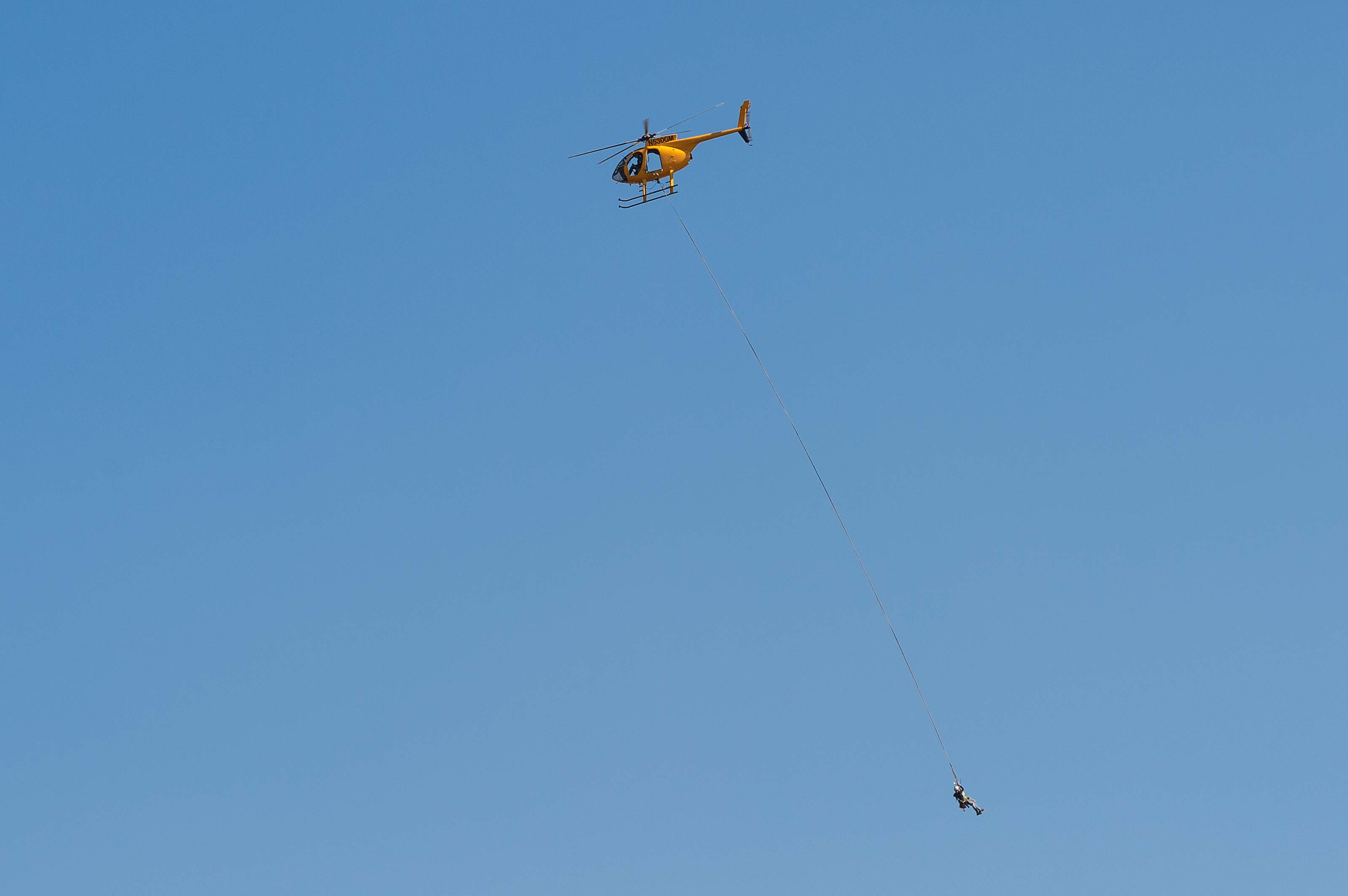 ART OF TRANSIT: I went for a hike in the Angeles National Forest on POTUS Day, looked up and saw this. There are actually two people dangling from the chopper -- they were doing work atop a nearby utility tower/transformer. Photo by Steve Hymon.