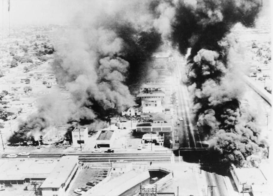 Buildings aflame in 1965. Photo: New York Telegram via Wikimedia.