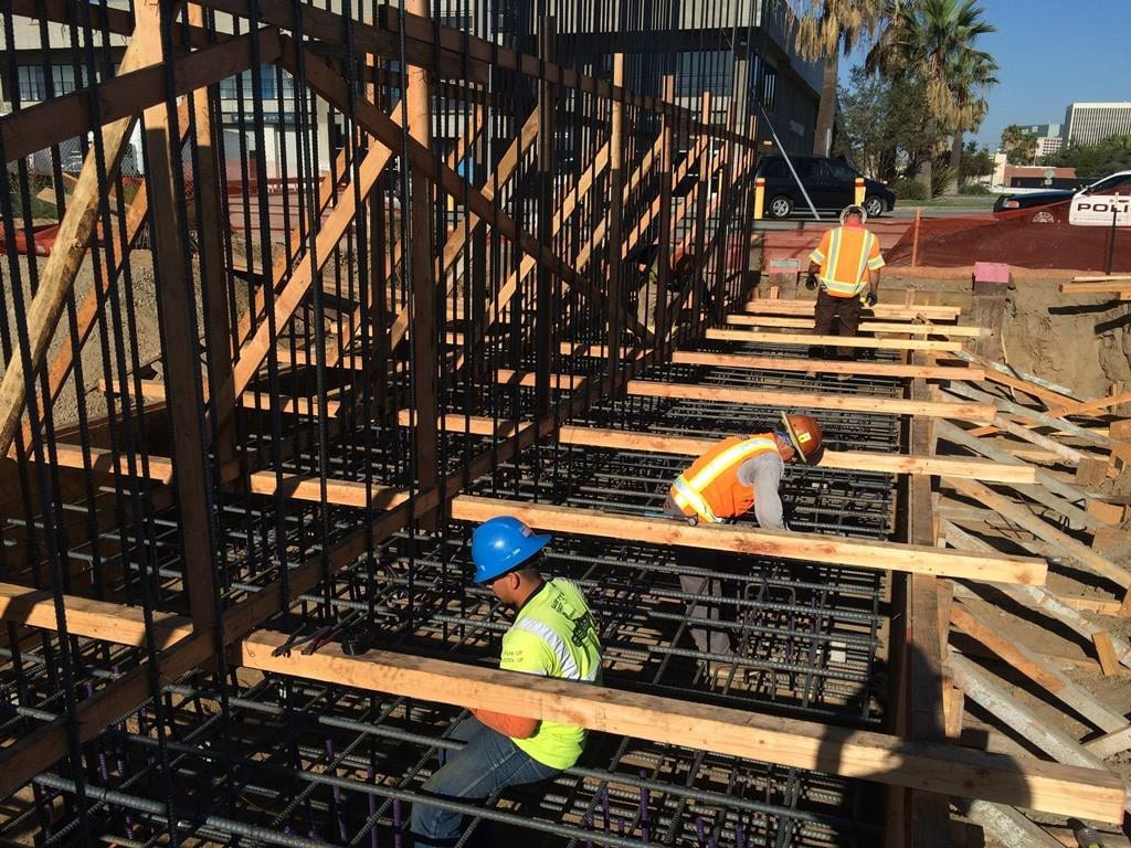 8.31.2015 AVIATION.CENTURY – Underpass abutment 1 footing debris removal and epoxy U-bar tying