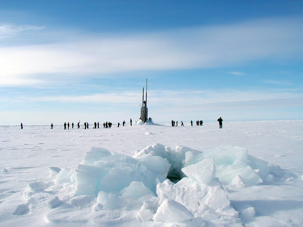Sailors stationed aboard the Los Angeles-class fast attack submarine USS Scranton explore the Artic ice surface in 2001. Photo: U.S. Navy.