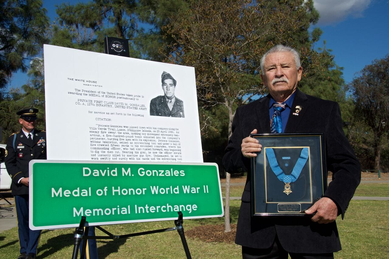 David M. Gonzales Jr. with his father's Medal of Honor.