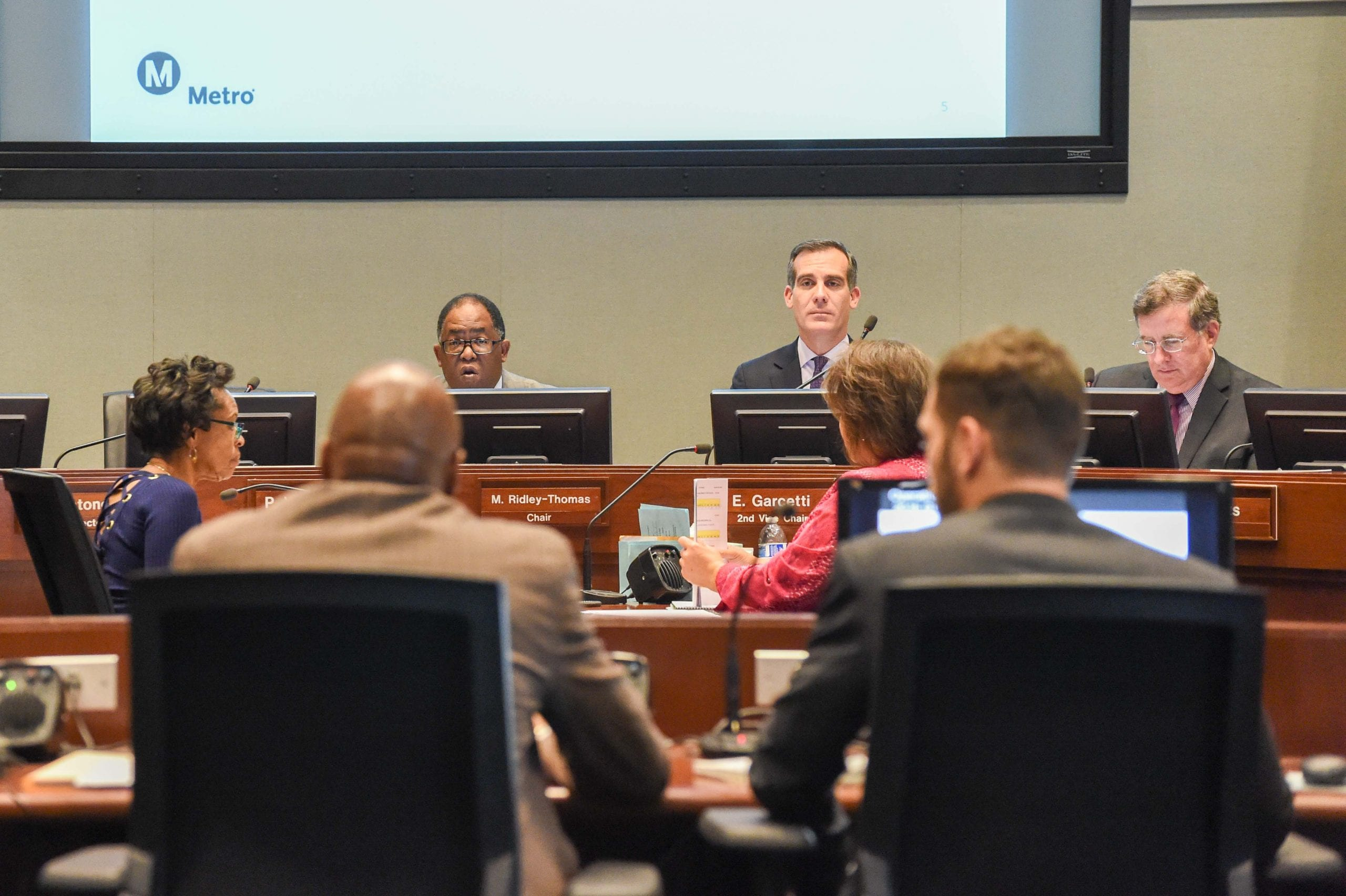 Metro Board Chair and Supervisor Mark Ridley-Thomas, left, and Board Member and L.A. Mayor Eric Garcetti listen to Washington's remarks on Thursday.