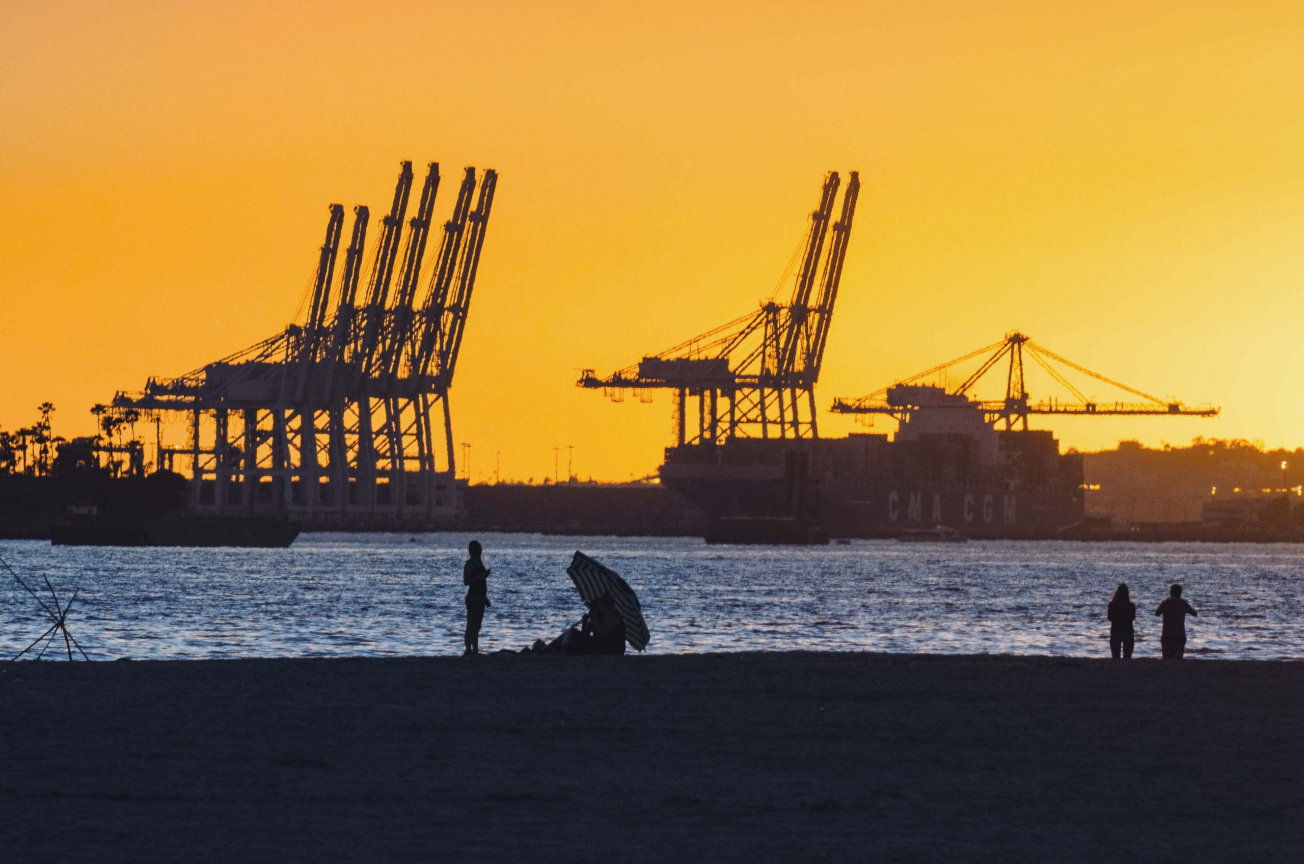 We don't post enough photos about goods movement. Sunset + beach + Port of Long Beach. Photo by Steve Hymon.