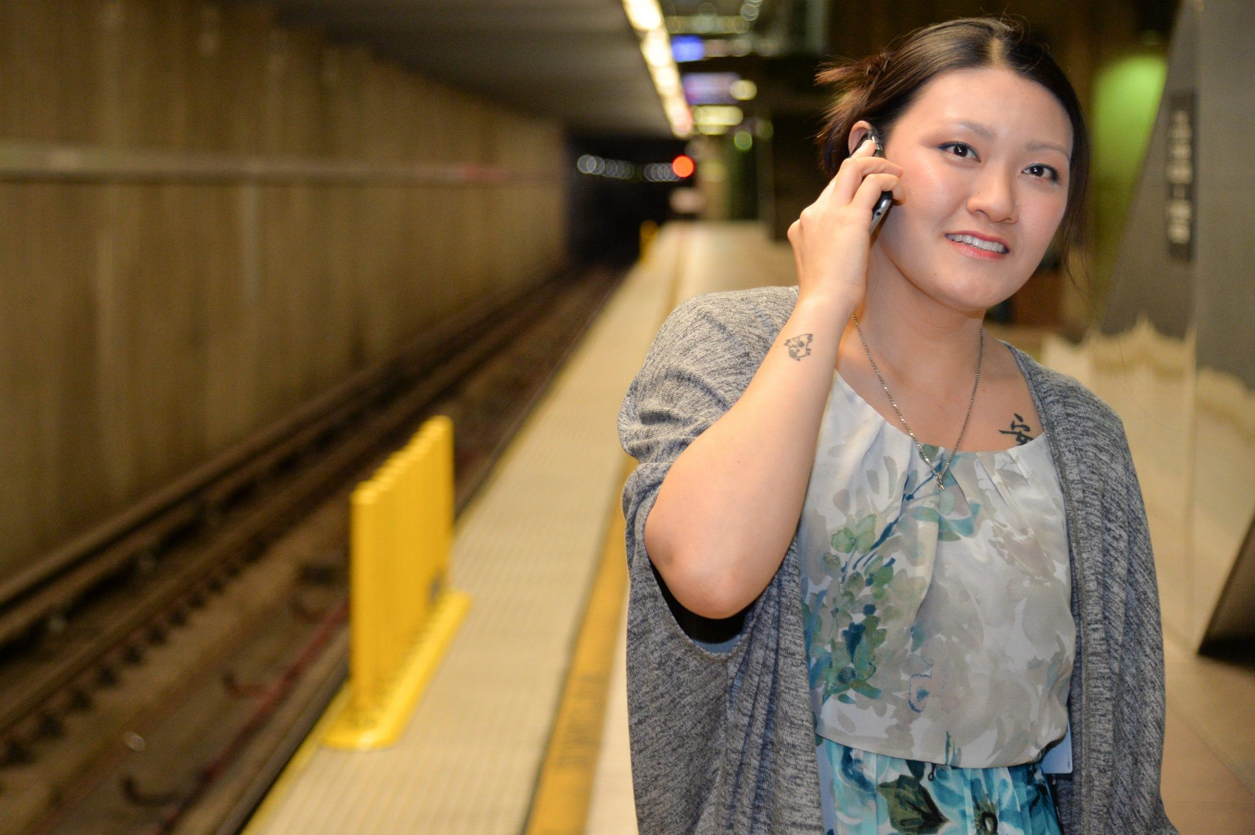 My colleague Anna enjoys a nonsensical cell phone conversation deep beneath Union Station. Photo: Steve Hymon/Metro.