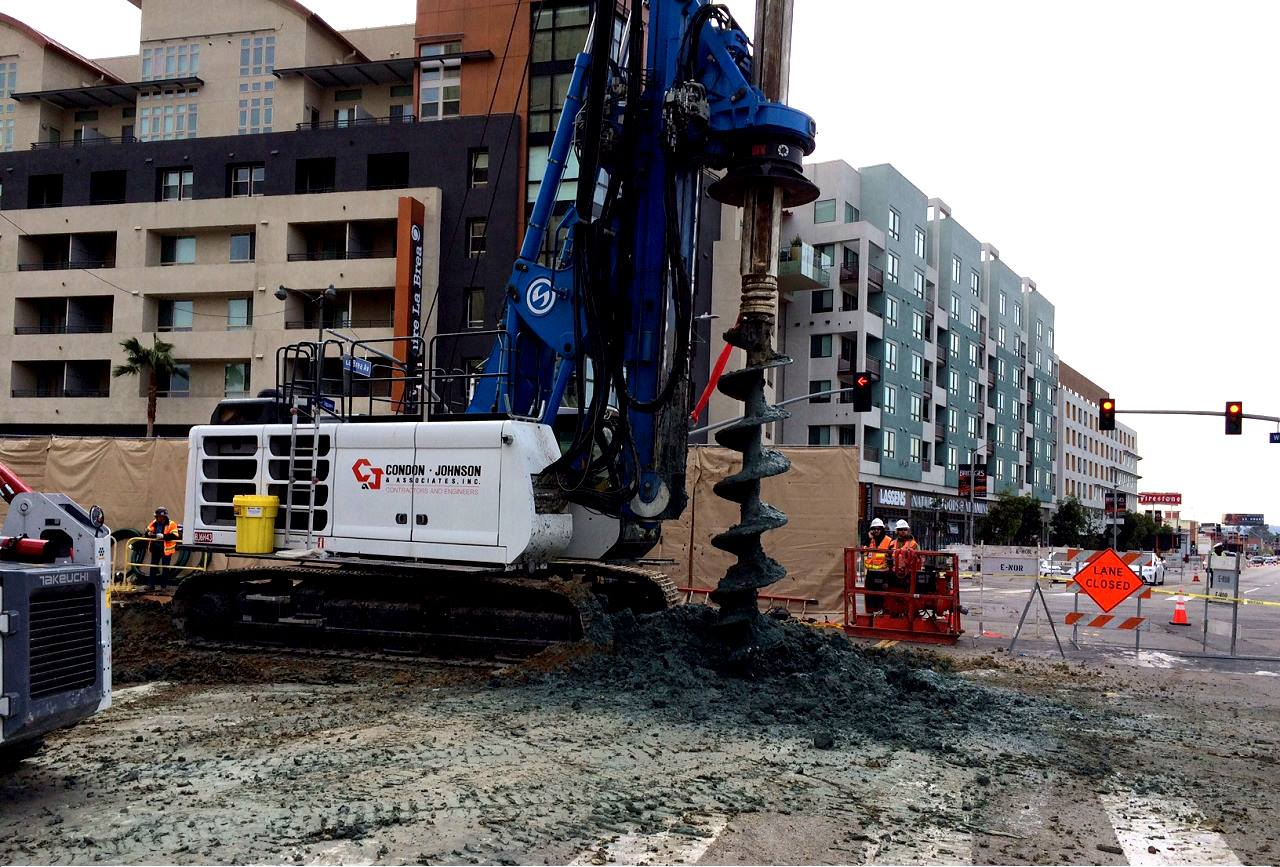 Workers drill a section of Wilshire Boulevard as part of the Purple Line Extension project's piling operation.