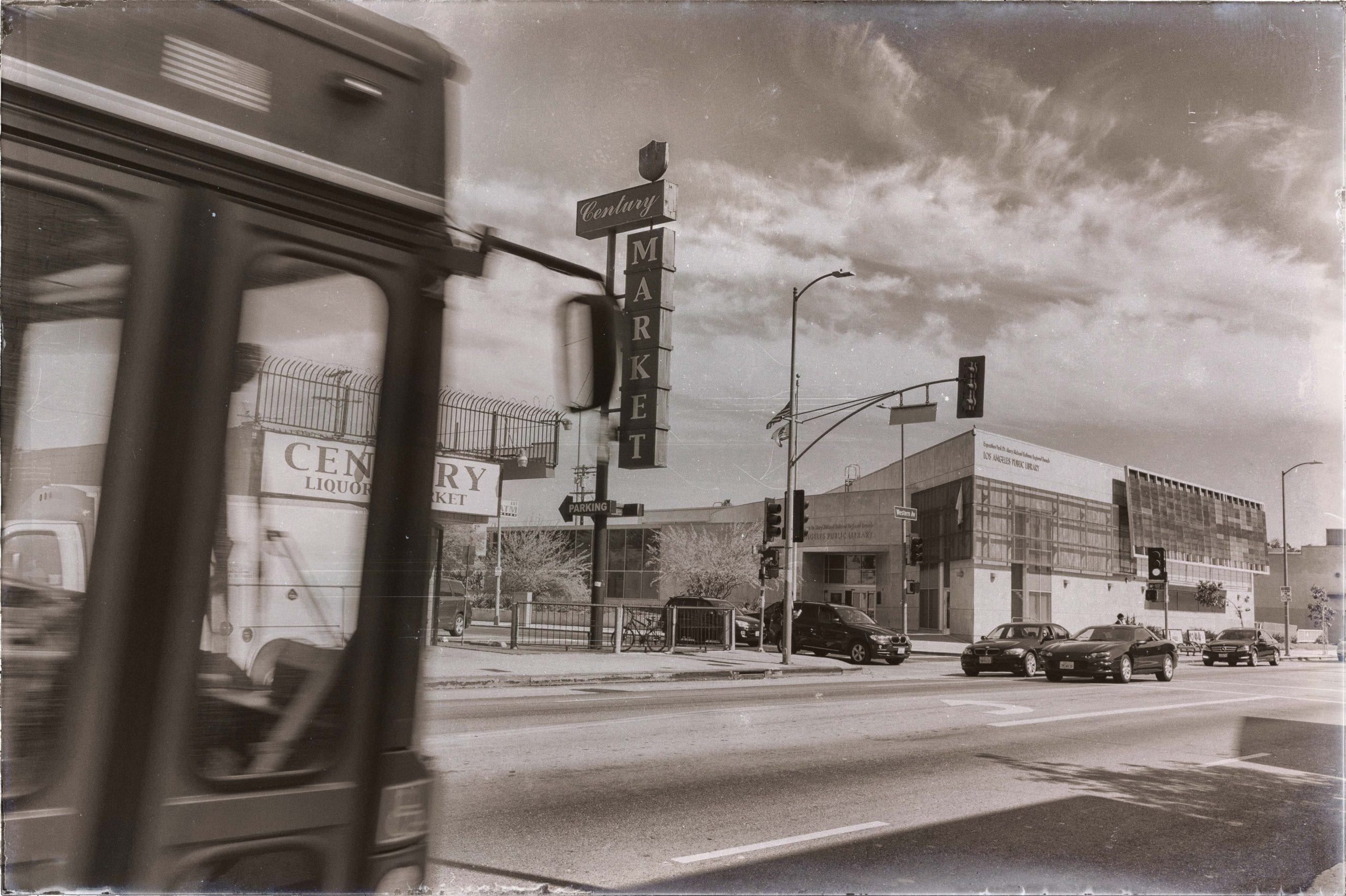 Bus + liquor store + public library on Western Avenue in South Los Angeles. Photo by Steve Hymon.